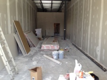 Photo of interior construction going on at our soon-to-come second location